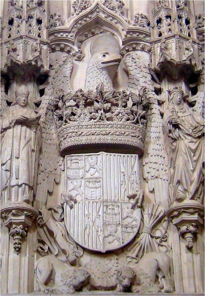 La primera labra heráldica de las armas de los Reyes Católicos se realizó, con toda probabilidad, en la iglesia de San Juan de los Reyes (Toledo), cuyo tenante es el águila de San Juan nimbada, divisa ya usada como princesa por Isabel.